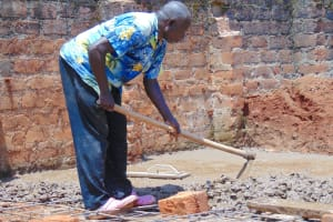The Water Project: Banja Secondary School -  Mixing Concrete Latrine Foundation