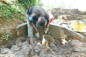 The Water Project: Imbinga Community, Imbinga Spring -  Plastering Interior Of Headwall
