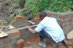 The Water Project: Buyangu Community, Mukhola Spring -  Pipe Measurements