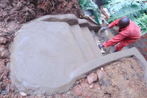 The Water Project: Bumira Community, Imbwaga Spring -  Cementing The Stairs