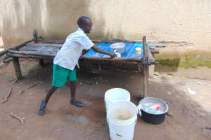 The Water Project: Galona Primary School -  Pupil Takes A Cup From The Dishrack