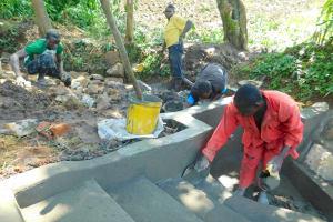 The Water Project: Imbinga Community, Imbinga Spring -  Plastering The Stairs