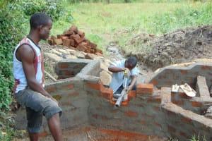 The Water Project: Buyangu Community, Mukhola Spring -  Pipe Setting