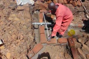 The Water Project: Bumira Community, Imbwaga Spring -  Pipe Setting