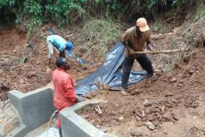 The Water Project: Kisasi Community, Edward Sabwa Spring -  Adding The Plastic Tarp