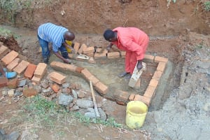 The Water Project: Shivembe Community, Murumbi Spring -  Wall Construction