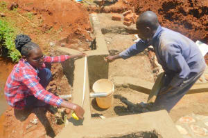 The Water Project: Shikhombero Community, Atondola Spring -  Field Officer Elvin Measures The Headwall