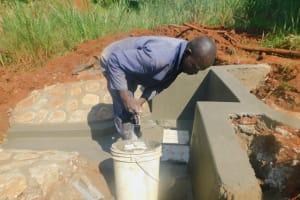 The Water Project: Shikhombero Community, Atondola Spring -  Plaster Work