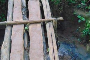 The Water Project: Kabinjari Primary School -  Narrow Bridge To The Spring
