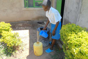 The Water Project: Gimarakwa Primary School -  Student Collecting Water From Home