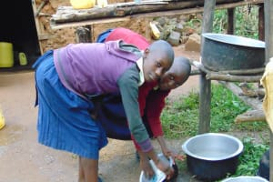 The Water Project: Kapsegeli KAG Primary School -  Pupils Wash Utensils At The Dishrack