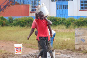 The Water Project: Kamimei Secondary School -  Carrying Materials To Latrine Site