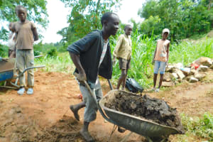 The Water Project: Imbinga Community, Imbinga Spring -  Bringing Clay For Backfilling