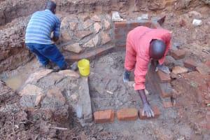 The Water Project: Bumira Community, Imbwaga Spring -  Rub Wall Stone Pitching