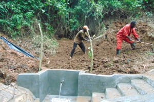 The Water Project: Kisasi Community, Edward Sabwa Spring -  Soil Backfilling Over Tarp