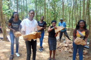 The Water Project: Shivembe Community, Murumbi Spring -  Interns Help Carry Stones To Site