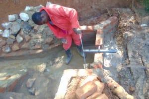 The Water Project: Shivembe Community, Murumbi Spring -  Pipe Setting