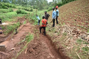 The Water Project: Busichula Community, Marko Spring -  Digging Cut Off Drainage Channels Above The Spring