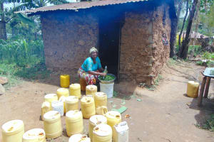The Water Project: Jamulongoji Primary School -  School Cook At Work Outside Kitchen