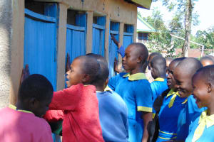 The Water Project: Gimomoi Primary School -  Girls Crowd At Their Latrines