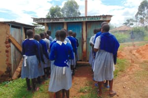 The Water Project: Saosi Primary School -  Girls Queueing At Their Latrines