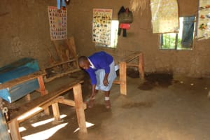 The Water Project: St. Martin's Primary School -  Student Sweeps Inside A Classroom