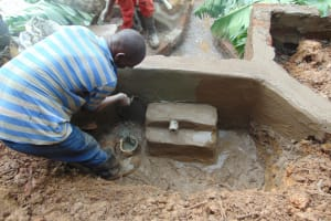 The Water Project: Bumira Community, Imbwaga Spring -  Plastering The Inside Of The Headwall