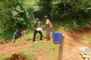The Water Project: Shikhombero Community, Atondola Spring -  Backfilling With Rocks