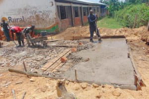 The Water Project: Mukama Primary School -  Pouring Latrine Foundation Over Pits