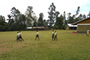 The Water Project: Wavoka Primary School -  Students Crossing The Football Field
