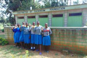 The Water Project: Shikomoli Primary School -  Girls At Their Latrine Block