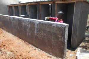 The Water Project: Ebukhayi Primary School -  Plastering Latrine Wall
