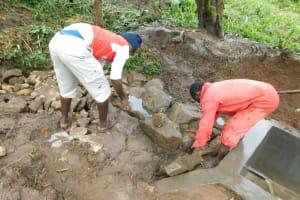 The Water Project: Imbinga Community, Imbinga Spring -  Backfilling