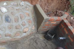 The Water Project: Shivembe Community, Murumbi Spring -  Completed Rub Wall