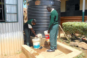 The Water Project: Friends School Manguliro Secondary -  Students Fetching Water From The Rainwater Harvesting Tank