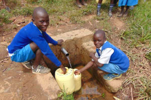 The Water Project: Jamulongoji Primary School -  Students Fetching Water From The Spring