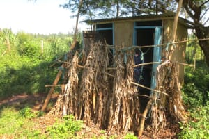 The Water Project: Mwikhupo Primary School -  Girls Latrines With Banana Leaf Doors