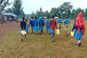 The Water Project: Kitagwa Primary School -  Students Going To Fetch Water