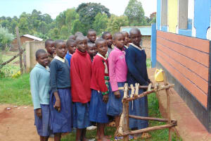 The Water Project: Kapsegeli KAG Primary School -  Girls In Line For Latrines