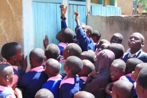 The Water Project: Gimengwa Primary School -  Girls Scrambling At The Toilets