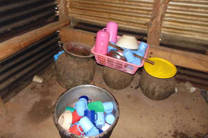 The Water Project: St. Joakim Buyangu Primary School -  Washed Utensils Drying Over Water Storage Pots