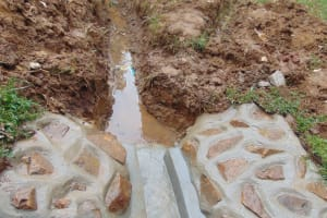 The Water Project: Bumira Community, Imbwaga Spring -  Drainage Channel Cleared