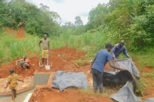 The Water Project: Shikhombero Community, Atondola Spring -  Adding Plastic Tarp