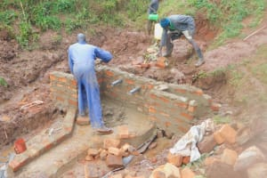The Water Project: Busichula Community, Marko Spring -  Wall Work Continues After Pipes Are Set