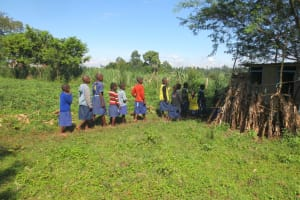 The Water Project: Mwikhupo Primary School -  Girls Lined Up To Use Latrines