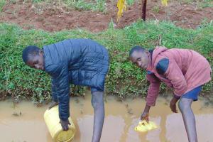 The Water Project: Kabinjari Primary School -  Students Fetching Water