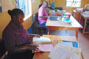 The Water Project: Gimomoi Primary School -  Teachers At Work Inside The Staffroom