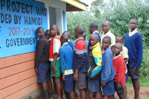 The Water Project: Kapsegeli KAG Primary School -  Boys In Line At The Latrines