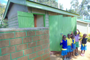The Water Project: Shikomoli Primary School -  Boys At Their Latrines