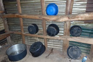 The Water Project: St. Joakim Buyangu Primary School -  Kitchen Wall Used As Dishrack